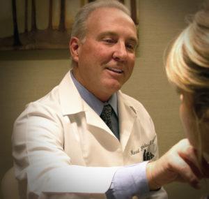 Dr. Randal DeFleice doing a skin care exam